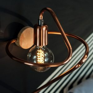 Create ambiance in a space of your choice with the Cu 130 Copper Wall Lamp.