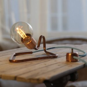 With a versatile design, the Cu 75 Copper Table Lamp is an uncommon accent for any desk, dresser or night stand.