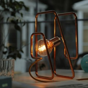 A chic addition to a modern loft, the Cu 244 Copper Table Lamp offers a ideal task lighting to your office.