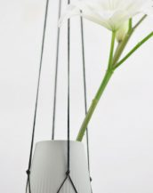 Perfectly matching almost any colored pot and plant, the Modern Macrame Plant Hanger Black works great in small rooms and on balconies.
