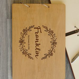 Available in A4 and A5 size, the Personalised Wooden Wedding Guest Book - Wreath is a beautiful Wedding Guest Book made of wood that will accurately keep your memories about this special day.