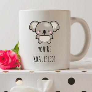 Sip your favourite tea or coffee with the You're Koalified Qualified Coffee Mug that makes a fantastic present or a little treat for yourself.