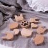 Shake up baby's playtime with the Mini Pet Paws Wooden Toys, created especially for clutching hands and curious mind.