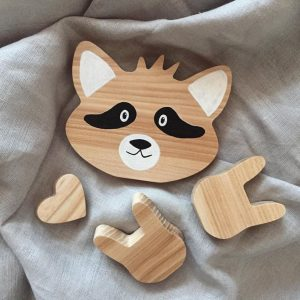 Shake up baby's playtime with the Raccoon Wood Toy, created especially for clutching hands and curious mind.
