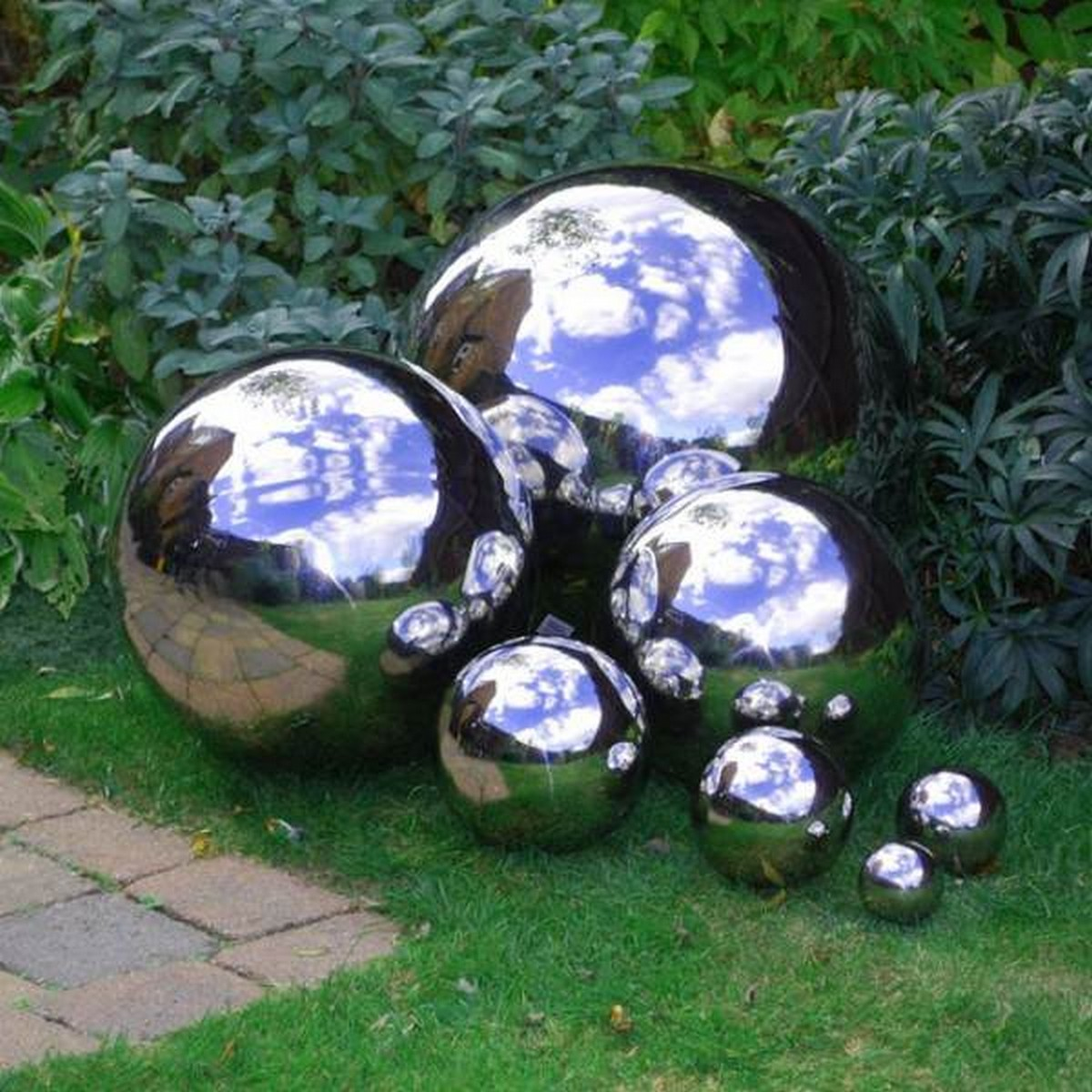 A gazing ball in the garden adds color and sparkle, plus it reflects the beauty of your flowers and the surroundings.