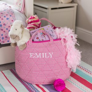 A practical home accessory for a child's bedroom, the Pink Gingham Toy Storage Basket is the perfect storage solution for keeping those runaway toys, books, shoes or laundry at bay.