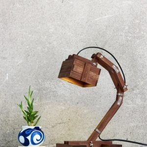 Create ambiance in a workspace of your choice with the Kran Evo Wooden Desk Lamp. This eye-catching piece of work holds an inspiring and creative style that would suit any professional environment.