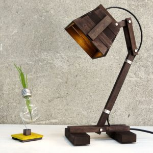 Create ambiance in a workspace of your choice with the Kran XI Wooden Desk Lamp. This eye-catching piece of work holds an inspiring and creative style that would suit any professional environment.