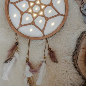 Perfect for setting a calm moon in your kid's bedroom, the Boho Dreamcatcher Decorative Night Light gives a soft glow when turned on.