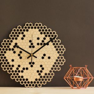 With a sophisticated and functional look, the Hexagon Wooden Wall Clock will add an element of starry spirit to any room.