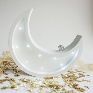 Perfect for setting a calm moon in your kid's bedroom, the Mini Moon Decorative Night Light gives a soft glow when turned on.