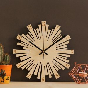 With a sophisticated and functional look, the Small Sunburst Wooden Wall Clock will add an element of starry spirit to any room.