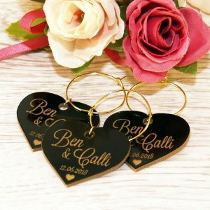 A great name tag which doubles up as a keepsake reminding them of your special day, the Personalised Glossy Heart Wedding Wine Charm will ensure that your guests know which drink belongs to them!