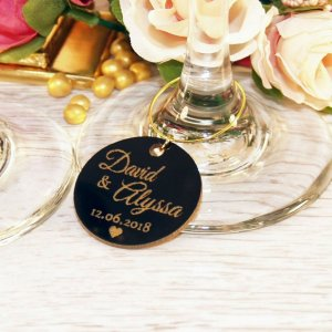A great name tag which doubles up as a keepsake reminding them of your special day, the Personalised Glossy Round Wine Glass Charm will ensure that your guests know which drink belongs to them!
