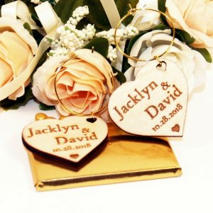 A great name tag which doubles up as a keepsake reminding them of your special day, the Personalised Wood Heart Wedding Wine Charm will ensure that your guests know which drink belongs to them!