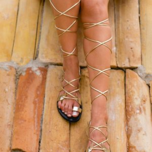 Just what every summer wardrobe needs, the Amphitrite Gold and Black Greek Leather Sandal is every woman's dream pair, super comfy and elegant, and easily combined with any outfit.