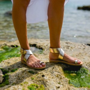 Just what every summer wardrobe needs, the Dione Gold Greek Leather Sandal is every woman's dream pair, super comfy and elegant, and easily combined with any outfit.