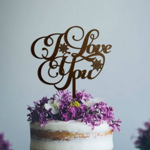 A lovely way to make your special cake unique, the 'I Love You' Wedding Cake Topper can be personalised to add to what should be a day of joy and happiness!