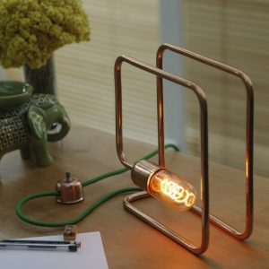 The Cu 172 Copper Table Lamp will bring a sleek and vintage industrial aesthetic to your home or office.