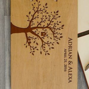 Available in A4 and A5 size, the Personalised Wooden Wedding Guest Book - Birds in Tree is a beautiful Wedding Guest Book made of wood that will accurately keep your memories about this special day.