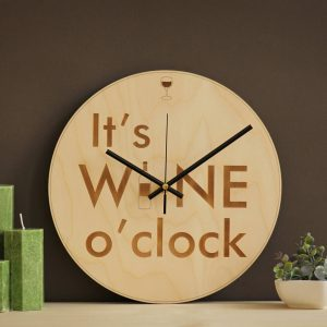 With a sophisticated and functional look, the It's Wine O'clock - Wooden Wall Clock will add an element of starry spirit to any room.