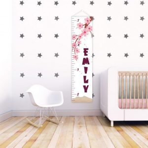 A perfect way to keep track of your little one's growth, the Pink Flowers Personalised Baby Growth Chart will brighten up any child's bedroom as well as provide a fun way to measure height.