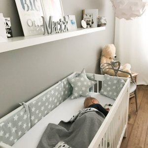 An incredibly useful and functional accessory for your baby's cot, the Mint & Grey Stars Crib Bumper ensures a cosy and soft environment for your baby.