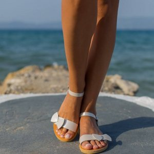Just what every summer wardrobe needs, the Aphrodite Bow Tie Greek Leather Sandal is every woman's dream pair, super comfy and elegant, and easily combined with any outfit.