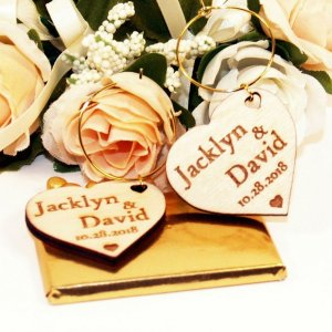 A great name tag which doubles up as a keepsake reminding them of your special day, the Personalised Heart Gold Ring Wedding Wine Charm will ensure that your guests know which drink belongs to them!