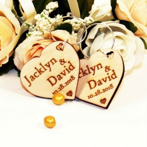 A great name tag which doubles up as a keepsake reminding them of your special day, the Personalised Heart Silver Ring Wedding Wine Charm will ensure that your guests know which drink belongs to them!