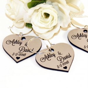 A great name tag which doubles up as a keepsake reminding them of your special day, the Personalised Silver Heart Wedding Wine Charm will ensure that your guests know which drink belongs to them!